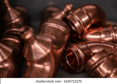 Close Up Copper Fittings on Black Background