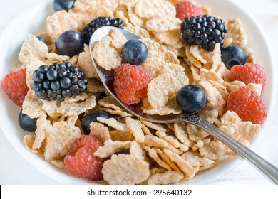 Close up to corn flakes and berry fruits on the bowl,selective focus