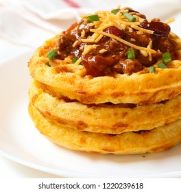 Close up of Cornbread cheddar waffles with bean chili isolated on white