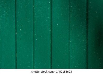 Close up of corrugated metal wall background of green fence. Copy space