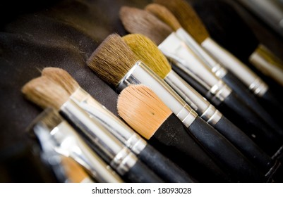 Close up of cosmetic brushes on black background