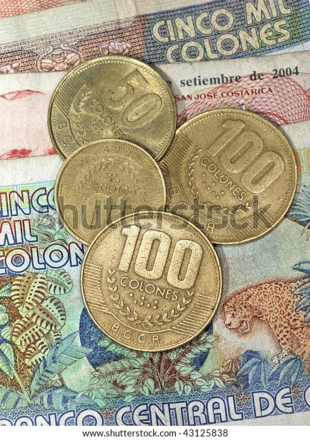 close up of costa rican colones notes and coins