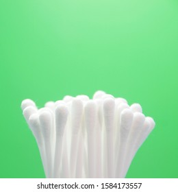 Close up Cotton buds or Cotton swab on green background.