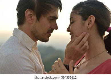 Close up of couple faces in love during sunset