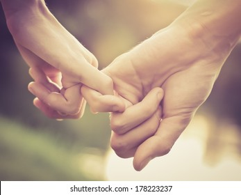 Close up of couple holding hands, vintage color