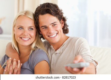Close up of a couple watching TV in their living room