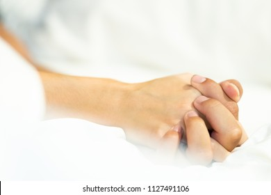 Close up couple's hand on bed. sex concept.