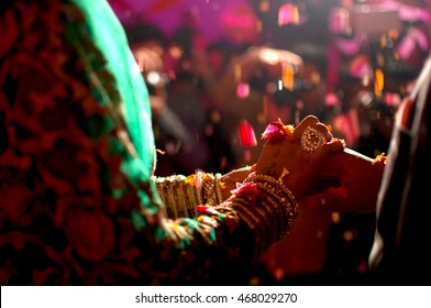Close up of couple's hands at a wedding, concept of hindu marriage/partnership/commitment