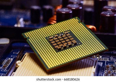 Close up of CPU Processor over Computer Motherboard. Tecnology background.