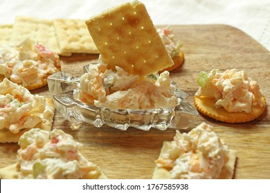 close up crab dip served with cracker - blur background - homemade food