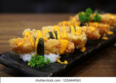 Close up Crab meat sticks tempura with sauce on black plate, Japanese food style
