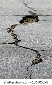 close up of a crack in the street