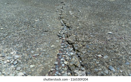 close up cracked cement floor because of earthquake or disaster