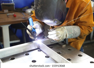 Close up of craftsman welding