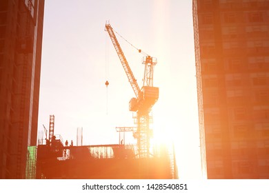 Close up of crane construction with flare light