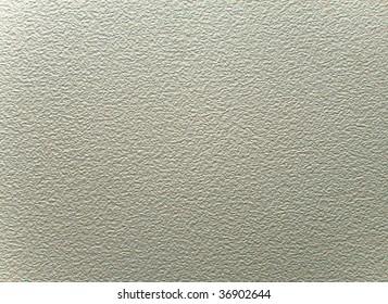 close up of a cream stucco wall