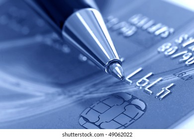 Close up a credit card and pen