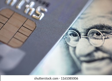 close up of credit card with rupee banknote