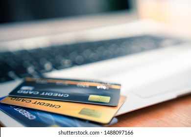 Close up of credit cards on a computer keyboard. Concept of internet purchase