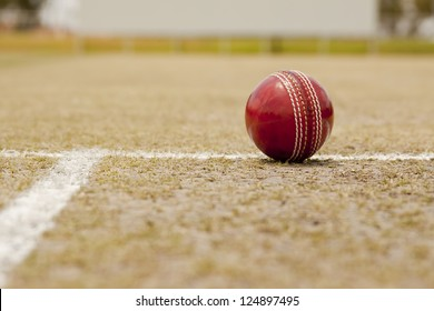 Close up Cricket ball on pitch with copy space