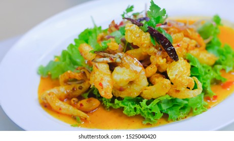 Close up Crispy Fish Maw in Spicy Salad with vegetable on white dish, thai food.