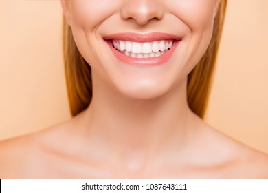 Close up cropped half face portrait of attractive, nude, natural, perfect, ideal girl with healthy white teeth isolated on beige background, perfection, wellness, wellbeing, restoration concept