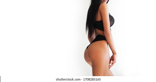 Close up cropped shot of girl in dark bra with big ass on white background, romantic, luxury, sensual, black hair, smooth skin, nice shapes, fit bottom, intimacy. Sexy girl and underwear concept.