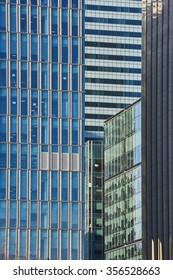 Close up cropped shot of skyscraper window frames in blue metal.