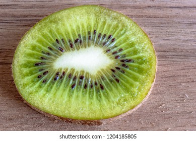 Close up of cross section of kiwi fruit. Healthy food ingredients. Benefits of Kiwi include being a sleep inducer and a fruit rich in vitamin C.