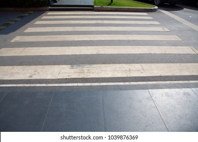close up crosswalk on the road for safety when people walking cross the street.