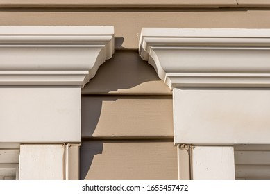 Close up of Crown molding accent above window, natural wood looking vinyl horizontal sliding