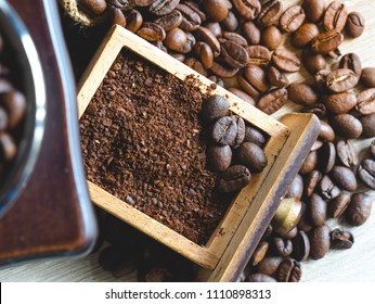 close up crushed coarse ground roasted coffee bean in wooden box of vintage grinder