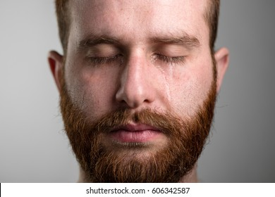 Close Up of a Crying Man with Red Beard