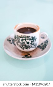 Close up of a cup of black coffee in a traditional Chinese porcelain coffee cup