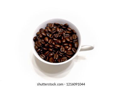 Close up a cup of coffee beans isolated on white background