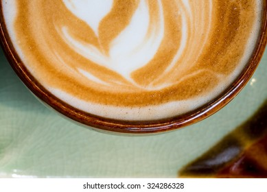Close up of a cup of coffee with latte art