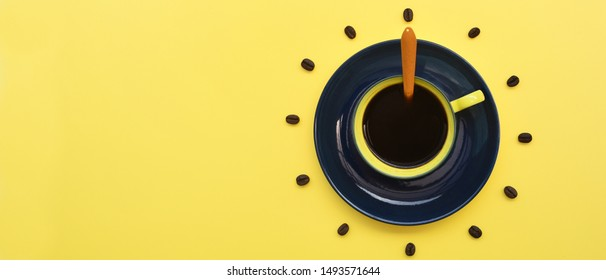 Close up of cup of coffee on yellow background