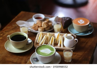 Close up a cup of Matcha green tea Latte art hot drink on wooden table background