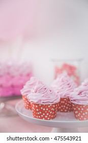 close up of a cupcake at sweet corner on pink birthay party theme