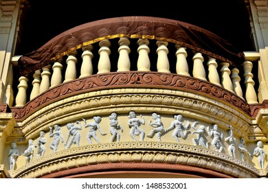 Close up of curved Indian balcony with stone balustrade and decorative carving  Hindu gods and deities