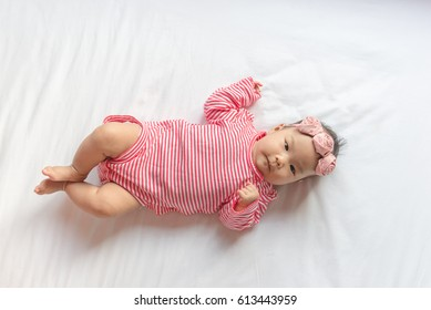 Close up cute baby with Headband lying on the bed