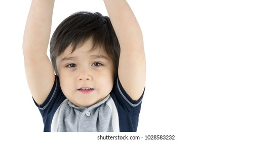 Close up cute boy hands up and looking at the camera with smiling face isolated on white background with copy space, mixed race boy, Healthy child Hands Up Concept