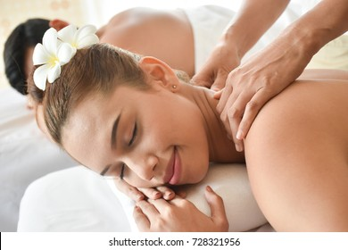 Close up cute girl in relaxing spa massage.