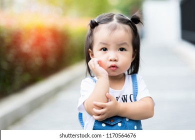 Close up cute little girl Asian happiness shot outdoors, 1-2 year old