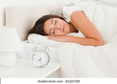 close up of a  cute woman sleeping under sheet in bedroom