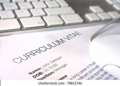 close up of a cv document with keyboard