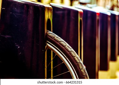Close up of a cycle tyre or bicycle parked in a stand of pay as you go cycling programme run in city