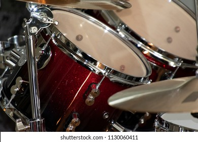 Close up of cymbals and drums, part of a drum kit.