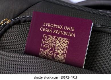 Close up of Czech Republic Passport in Black Suitcase Pocket