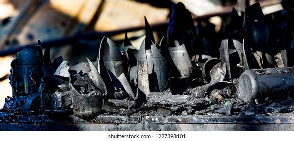 Close up damaged supermarket glass plastic bottles after arson fire with burn black dark debris  waiting for investigation for insurance. Saturated contrasting effect dramatic atmosphere